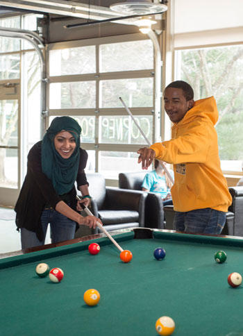Mason students play pool in the Hub